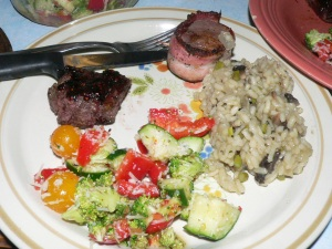 Duck with bacon wrapped venison, risotto, and salad.  We think we are epi-curious cooks.