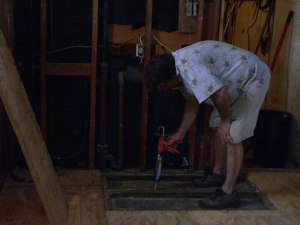 Bob used Liquid Nails to tack treated 2 x 4's to the concrete floor and then glued and screwed plywood decking.